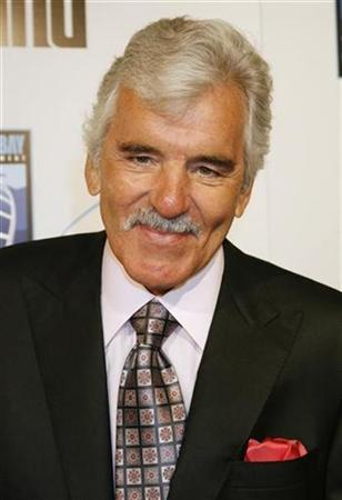 Actor Dennis Farina poses at the premiere of his new film ''The Grand'', set in the world of professional poker, in Hollywood, California March 5 2008 . REUTERS/Fred Prouser
