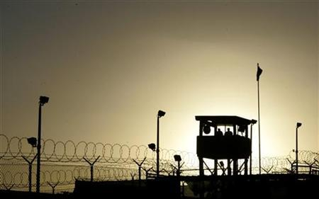 U.S. Army troops stand guard over the Sally Port One entrance to Camp Delta where detainees are held at the United States Naval Base in Guantanamo Bay, Cuba January 18, 2006. REUTERS/Joe Skipper
