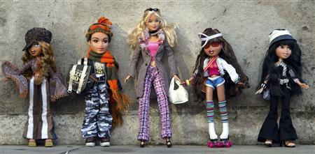 MGA's Bratz dolls and a Mattel Barbie Doll (C) are seen at the Dream Toys 2004 exhibition, sponsored by the Toy Retailers Association in London in this October 6, 2004 file photo. REUTERS/Stephen Hird/Files