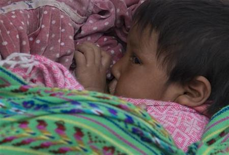 A Tarahumara child is breastfed by his mother in the hamlet of Rikinapuchi, northern Chihuahua state, Mexico, January 22, 2008. REUTERS/Tomas Bravo