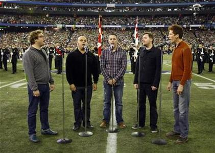 Members of the band Barenaked Ladies sing the national anthem before the start of the 95th Grey Cup football championship in Toronto November 25, 2007. REUTERS/Shaun Best