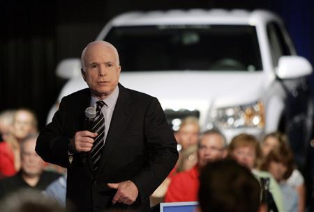 Republican presidential candidate Senator John McCain (R-AZ) addresses the audience about electric vehicles during a campaign stop at the General Motors Technical Center in Warren, Michigan July 18, 2008. REUTERS/Rebecca Cook