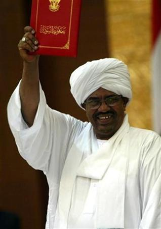 Sudan's President Omar Hassan al-Bashir holds Sudan's new election law book in Khartoum in this file photo from July 14, 2008. World powers should heed the worries of African and Arab states in responding to genocide charges against Sudan's president, China's envoy on Darfur said, warning that the court steps could imperil peace efforts.REUTERS/Mohamed Nureldin Abdalla