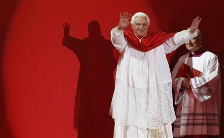 Pope Benedict XVI acknowledges thousands of World Youth Day pilgrims at an outdoor evening vigil at Randwick horse racing track in Sydney July 19, 2008. REUTERS/Mick Tsikas