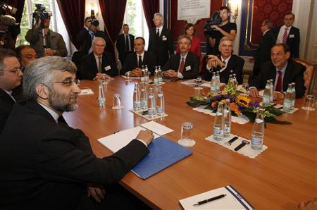 Iran's chief nuclear negotiator Saeed Jalili (L) smiles before a meeting on nuclear issues with E.U. foreign policy chief Javier Solana (R) at the Town Hall in Geneva July 19, 2008. World powers will sound out Iran's readiness to negotiate an end to the long dispute over its nuclear programme on Saturday, and Tehran said more such meetings might be needed. REUTERS/Denis Balibouse
