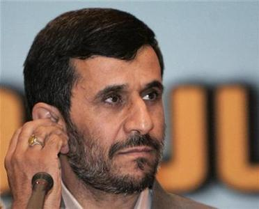 Iranian President Mahmoud Ahmadinejad adjusts his earphone during a news conference after the Eight Developing Islamic Nations summit in Kuala Lumpur July 8, 2008. REUTERS/Zainal Abd Halim