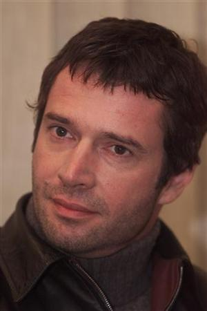 British actor James Purefoy looks on during a media brief in Snagov (30km north Bucharest) December 16, 2003. REUTERS/Bogdan Cristel