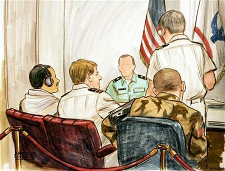 In this courtroom illustration, Salim Ahmed Hamdan (L) appears with appointed council Lieutenant Commander Charles Swift (2nd-L) during a preliminary hearing held on the Naval Base at Guantanamo Naval Base August 24, 2004. REUTERS/POOL/Illustration by Art Lein