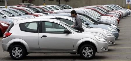 A Ford worker walks past the new Ford Ka car lined up at Ford's plant in Sao Bernardo do Campo, on the outskirts of Sao Paulo, December 13, 2007. Ford is about to alter its focus drastically and build more small cars, the New York Times said on Tuesday, citing people familiar with the plans. REUTERS/Paulo Whitaker