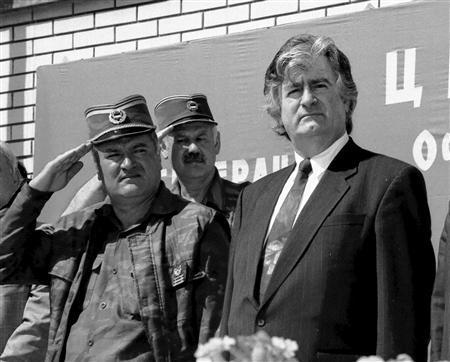 Radovan Karadzic (R) and Gen. Ratko Mladic (L) are pictured in Banja Luka in this June 26,1995 file photo. REUTERS/Ranko Cukovic/Files