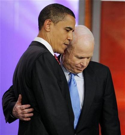Presidential candidates Senator Barack Obama (D-IL) (L) and Senator John McCain (R-AZ) meet onstage between back to back Republican and Democratic debates at St Anselems College in Manchester, New Hampshire in this January 5, 2008 file photo. REUTERS/Brian Snyder