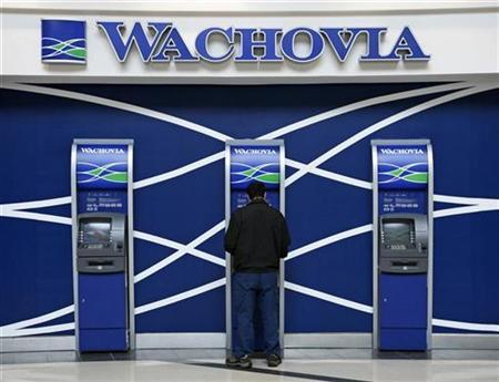A man uses a Wachovia ATM machine in the Hartsfield-Jackson International Airport in Atlanta, Georgia, April 14, 2008. REUTERS/Mike Blake