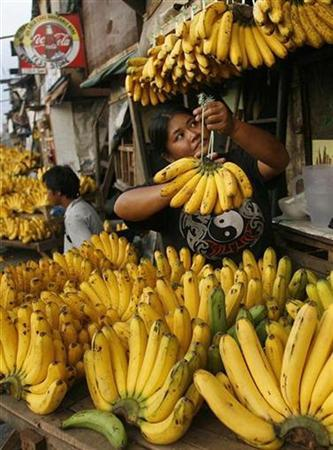 A vendor displays bananas for sale along a road in the Port area of Manila in this file picture. REUTERS/Cheryl Ravelo