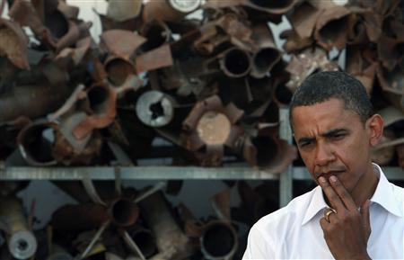 Democratic presidential candidate Senator Barack Obama (D-IL) stands in front of a display of the remains of rockets, fired by Palestinian militants in Gaza, during a visit to a police station in the southern Israeli town of Sderot July 23, 2008. REUTERS/David Silverman/Pool