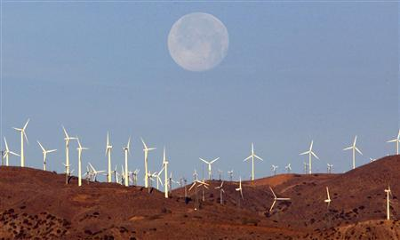 The full moon sets behind a wind farm in the Mojave Desert in California, in this January 8, 2004 file photo. REUTERS/Toby Melville/Files