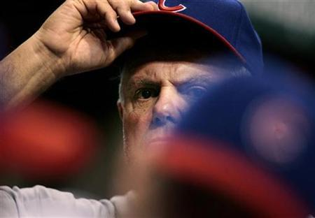 Chicago Cubs manager Lou Piniella adjusts his cap during the eighth inning of their interleague baseball game against the Tampa Bay Rays in St. Petersburg, Florida June 17, 2008. REUTERS/Scott Audette