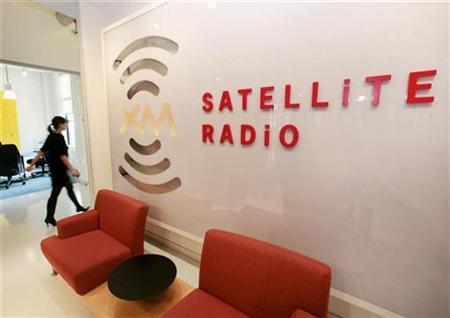 A woman walks past the waiting area of the XM Satellite Radio building after the U.S. Justice Department approved that Sirius Satellite Radio's $4.59 billion purchase of rival XM Satellite Radio would be given antitrust clearance in Washington, March 25, 2008. XM Satellite Radio Holdings and Sirius Satellite Radio said they could pay up to $19 million to settle past compliance issues with federal regulators, a move that helps clear the way for U.S. Federal Communications Commission approval of their merger. REUTERS/Larry Downing