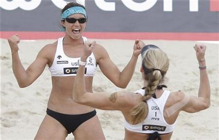 Kerry Walsh (R) and Misty May-Treanor of the U.S. celebrate after winning the final match against Jie Wang and Jia Tiang of China at the FIVB Beach Volleyball World Tour Grand Slam in Berlin in this June 14, 2008 file photo. REUTERS/Johannes Eisele/Files