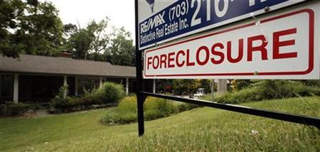 A foreclosure sale sign sits in front of a house in Falls Church, Virginia, just outside Washington D.C. July 23, 2008. REUTERS/Kevin Lamarque