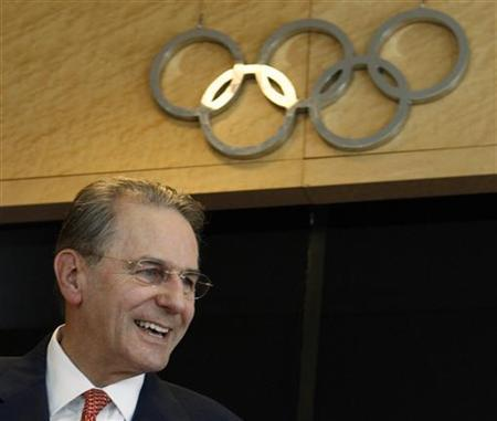 International Olympic Committee (IOC) President Jacques Rogge smiles before a news conference at the IOC headquarters in Lausanne June 23, 2008. Rogge cannot speak in detail about human rights in China for diplomatic reasons, he said in an interview on Saturday. REUTERS/Denis Balibouse