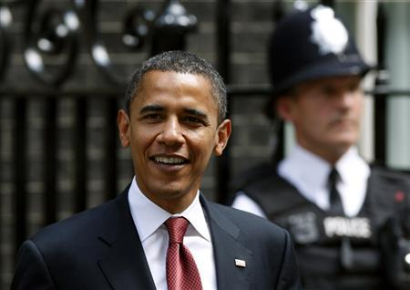 U.S. Democratic presidential candidate Senator Barack Obama (D-IL) smiles as he leaves 10 Downing Street in central London July 26, 2008. REUTERS/Alessia Pierdomenico