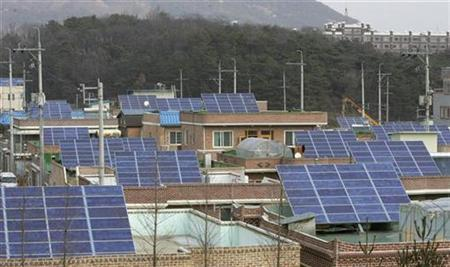 File photo shows a view of a solar house village in Kwangju, about 320 km (200 miles) south of Seoul, February 1, 2007. REUTERS/An Hyun-ju