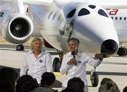 Virgin Group's Founder billionaire Richard Branson (L) and Burt Rutan, president of Scaled Composites, take questions from the media as they sit in front of Virgin Galactic's mothership WhiteKnightTwo during its public roll-out in Mojave, California July 28, 2008. REUTERS/Fred Prouser