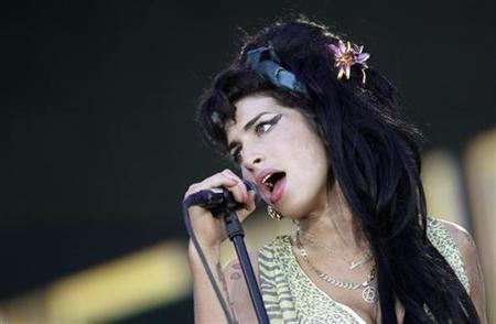 British singer Amy Winehouse performs during the ''Rock in Rio'' music festival in Arganda del Rey, near Madrid, July 4, 2008. REUTERS/REUTERS//Juan Medina
