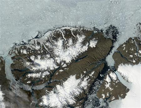 A 2006 satellite image of the Ward Hunt ice shelf in the Canadian Arctic. Giant sheets of ice totaling almost eight square miles broke off the ice shelf last week and more could follow later this year, scientists said on Tuesday. REUTERS/Jacques Descloitres, MODIS Rapid Response Team, NASA/GSFC/Handout