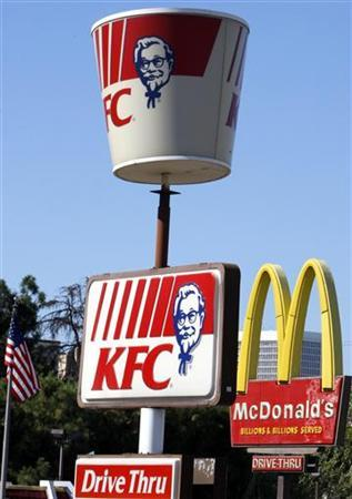 KFC and McDonald's signboards are shown in Los Angeles October 3, 2007. REUTERS/Lucy Nicholson