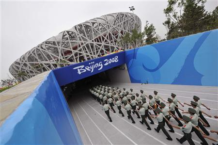 Paramilitary policemen march into the National Stadium, also known as the Bird's Nest, at the Olympic Green in Beijing, July 30, 2008. REUTERS/Joe Chan