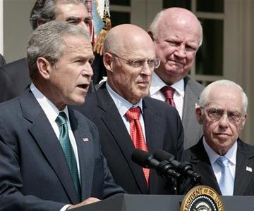 President Bush speaks in the Rose Garden of the White House about the economy and energy reserves after a Cabinet meeting July 30, 2008. From L-R are: Bush, Secretary of Treasury Henry Paulson, Secretary of Energy Samuel Bodman and Attorney General Michael Mukasey. REUTERS/Larry Downing
