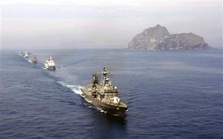 South Korean navy vessels participate in a defense drill with its air force near Dokdo on the East Sea, July 30, 2008. The small cluster of islands is called Takeshima in Japanese. REUTERS/South Korean Navy/Handout