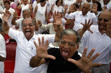 Members of laughter club participate in a laughing exercise in Mumbai May 4, 2008. REUTERS/Punit Paranjpe