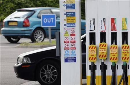 ''Out of use'' signs are seen on pumps at a dry Shell petrol station in Leicester, June 15, 2008. REUTERS/Darren Staples