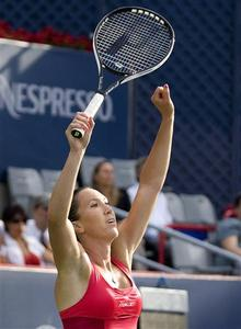 Jelena Jankovic of Serbia celebrates her win against Canada's Stephanie Dubois at the Rogers Cup tennis tournament in Montreal, July 31, 2008. REUTERS/Christinne Muschi