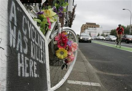 A ''ghost bike'' memorial marks the spot where a cyclist was killed in 2007 in an accident with a truck in Portland, Oregon, July 29, 2008. REUTERS/Richard Clement