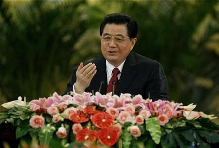 Chinese President Hu Jintao gestures as he answers journalists questions during a group interview at the Great Hall of the People in Beijing August 1, 2008. REUTERS/Reinhard Krause