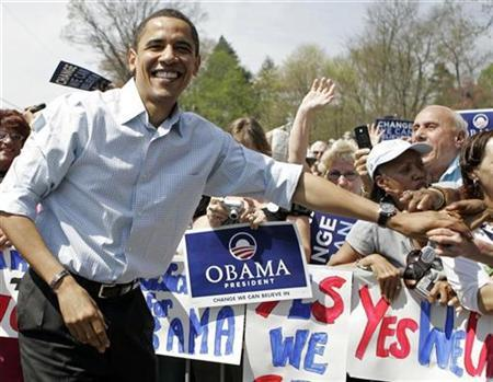 Democratic presidential candidate Senator Barack Obama shakes hands with supporters at the Wynnewood Station near Philadelphia, April 19, 2008. REUTERS/Tim Shaffer
