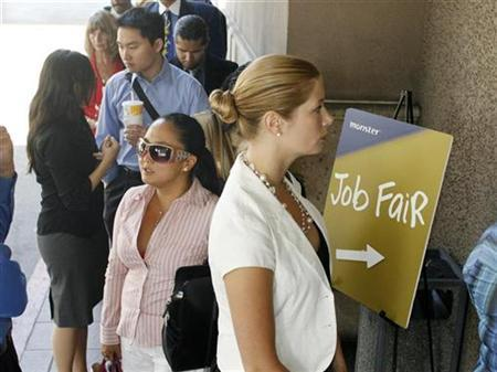 Bridget Dougherty (R) waits in line to enter a Monster.com job fair in Los Angeles, California July 23, 2008. REUTERS/Fred Prouser