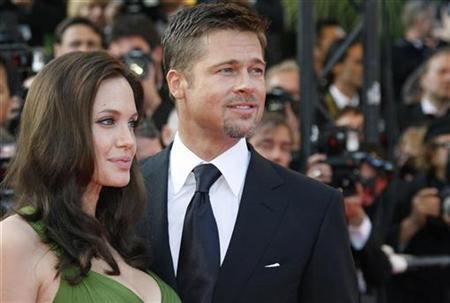 Voice actor Angelina Jolie (L) and Brad Pitt arrive for the screening of the animated film ''Kung Fu Panda'' by directors Mark Osborne and John Stevenson at the 61st Cannes Film Festival May 15, 2008. REUTERS/Vincent Kessler