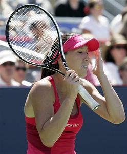 Jelena Jankovic of Serbia reacts during her match against Slovakia's Dominika Cibulkova at the Rogers Cup tennis tournament in Montreal, August 1, 2008. REUTERS/Christinne Muschi