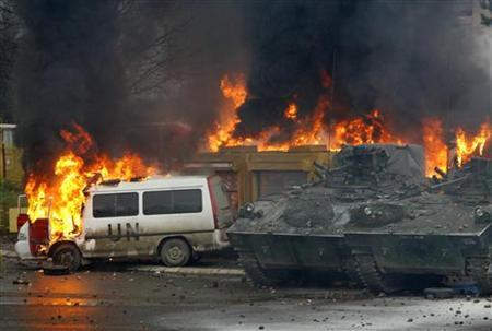 French NATO peacekeeping vehicles burn during clashes with Serb protesters in the ethnically divided city of Mitrovica March 17, 2008. REUTERS/Marko Djurica