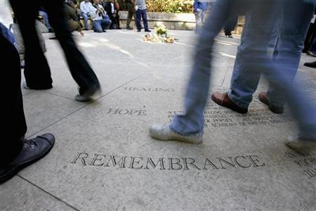 People walk around the Circle of Friends at the National AIDS Memorial Grove on World Aids Day in San Francisco, California, December 1, 2006. REUTERS/Kimberly White