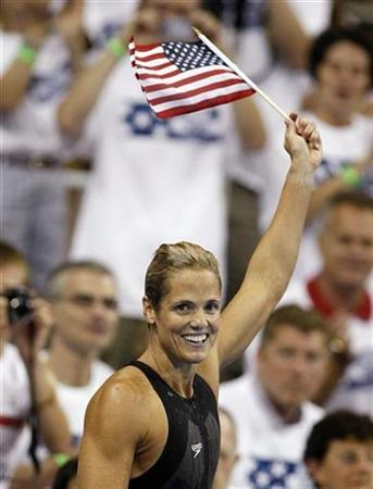 Dara Torres celebrates after she won the women's 100m freestyle at the U.S. Olympic Swimming Trials in Omaha, Nebraska July 4, 2008. Torres, who is 41 and has a two-year-old daughter, created a media stir by making it to her fifth Olympics as the oldest American to swim at the Games. REUTERS/Christinne Muschi