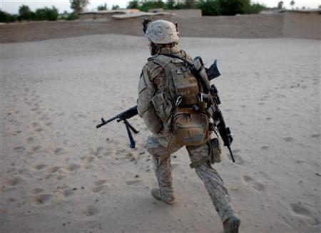 A U.S. Marine, from the 24th Marine Expeditionary Unit, runs for cover near the town of Garmser in Helmand Province May 19, 2008. REUTERS/Goran Tomasevic