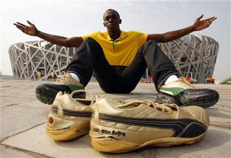 Current world record holder in the 100m sprint, Jamaica's Usain Bolt, poses for a picture in front of the National Stadium, also known as the Bird's Nest, ahead of the Beijing 2008 Olympic Games August 5, 2008. REUTERS/Hans Deryk