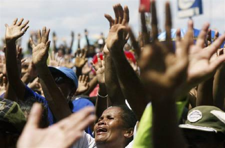 Christian Papuans sing a religious song during a protest in Jayapura of the Indonesia Papua province August 5, 2008. REUTERS/Oka Barta Daud