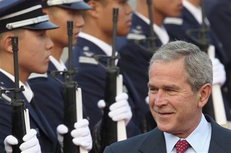 President George W. Bush arrives at a military airport in Seongnam, south of Seoul August 5, 2008. REUTERS/Lee Sang-hak/Yonhap