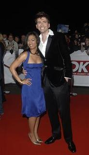 British actors Freema Agyeman (L) and David Tennant pose at the ''National Television Awards'' at the Royal Albert Hall in London October 31, 2007. REUTERS/Anthony Harvey